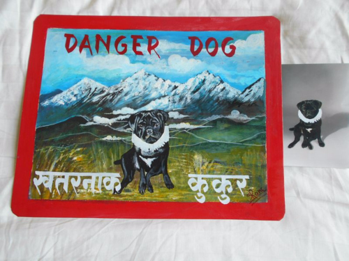 Folk art portrait of a black Pug hand painted against a backdrop of the Himalayas in Nepal
