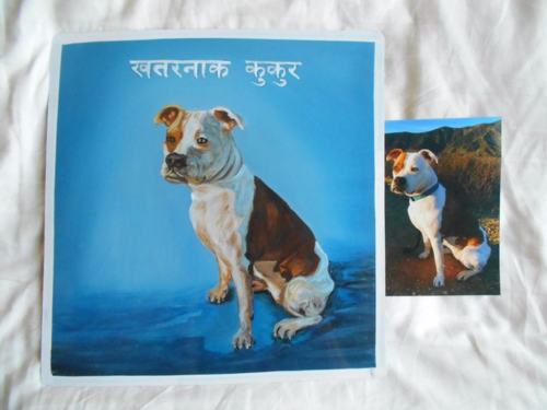 Folk art portrait of an American Bulldog hand painted on metal in Nepal