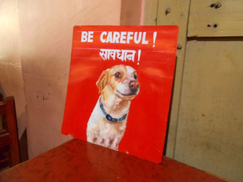Folk art beware of Jack Russell sign hand painted on metal in Nepal