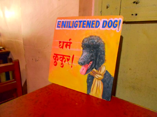 Folk art portrait of a Black Standard Poodle hand painted on metal in Nepal