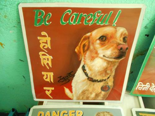 folk art portrait of a Jack Russell Terrier hand painted on metal in Nepal