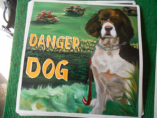 Folk art portrait of a Springer Spaniel hand painted on metal by a sign painter in Nepal