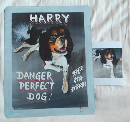 folk art portrait of a Cavalier King Spaniel hand painted on metal in Nepal