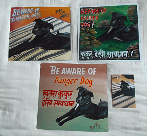 Folk art beware of dog sign hand painted on metal by a signboard artist in Nepal
