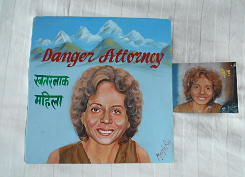 Folk art beware of Attorney hand painted on metal in Nepal
