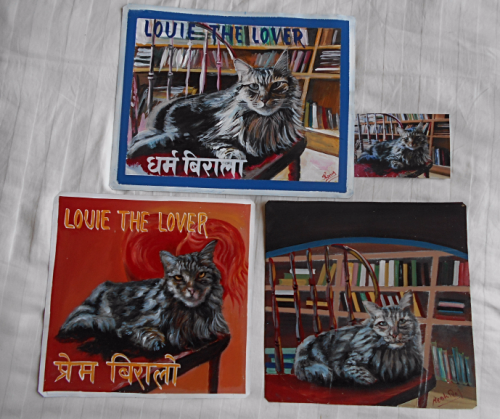 folk art Tabby Cat portrait hand painted on metal in Nepal.