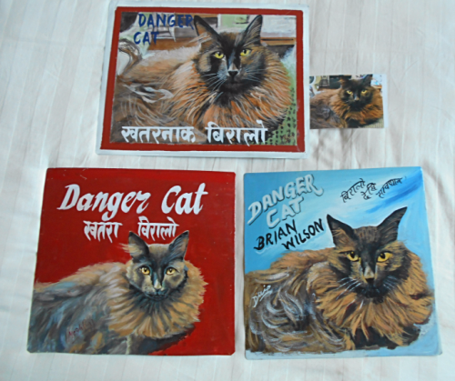 Folk at beware of Cat art hand painted on metal in Nepal