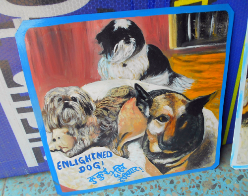Folk art portrait of Shih Tzu mix dogs and a German Shepherd hand painted on metal in Nepal