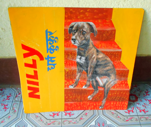 Folk art portrait of a rescue dog from Puerto Rico, hand painted on metal in Nepal