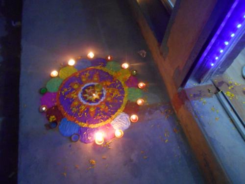 A colorful rangoli beckons Laxmi into a shop