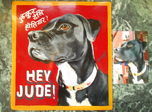 Folk art portrait of a hound dog hand painted on metal in Nepal