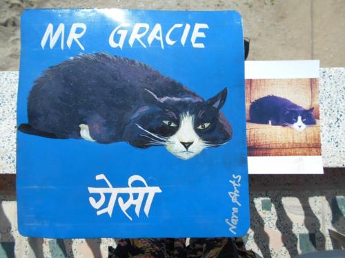 Folk art portrait of a Tuxedo Cat hand painted on metal