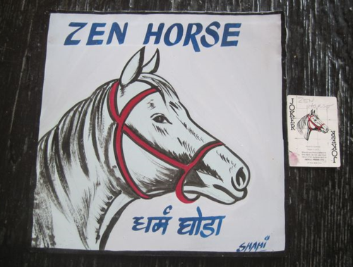 Folk art White Horse hand painted on metal from an image on a playing card.   From Nepal.