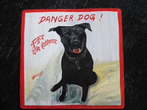 Beware of Black Dog folk art sign hand painted on metal in Nepal