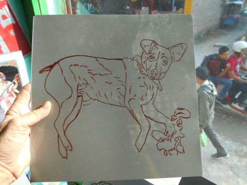 folk art beware of Terrier hand painted on metal by a sign painter in Nepal
