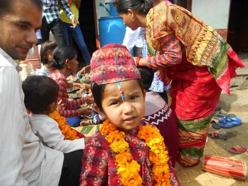 Young boy with tika on Bhai Tika in Nepal