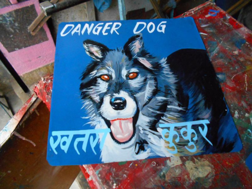 Folk art Collie Husky mix hand painted on metal in Nepal