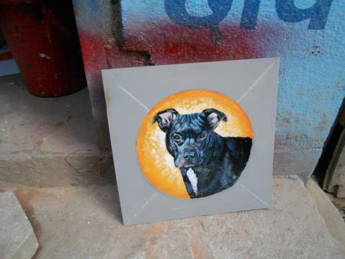 Folk art Pit Bull hand painted on metal in Nepal