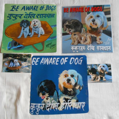 Folk art Rescue Dogs hand painted on metal in Nepal