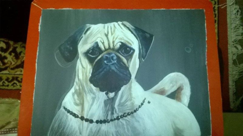 Folk art Pug dog hand painted on metal in Nepal