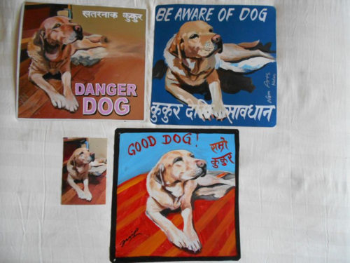 Folk art Labrador Retriever hand painted on metal in Nepal