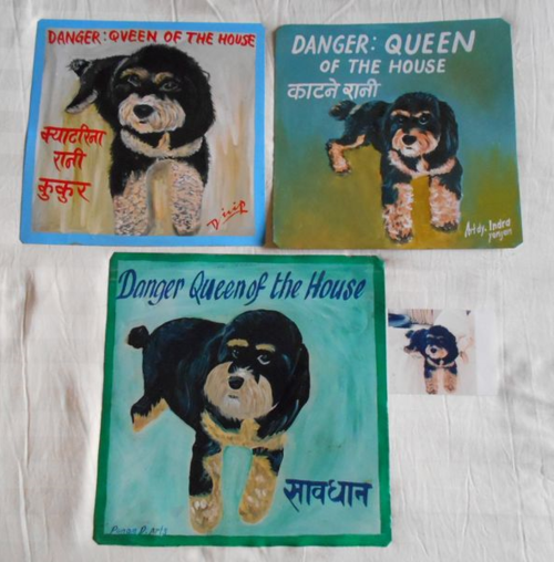Folk art Cavapoo hand painted on metal by a sign painter in Nepal