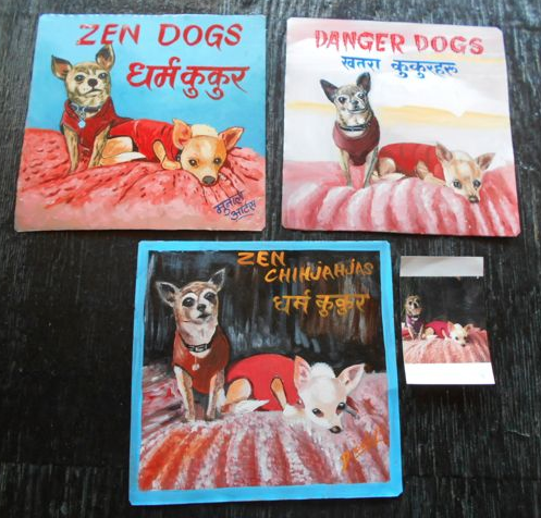 Folk art Chihuahuas hand painted on metal in Nepal