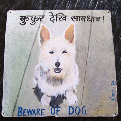 A White Scottish Terrier by Hari Prasad is hand painted on metal in Nepal