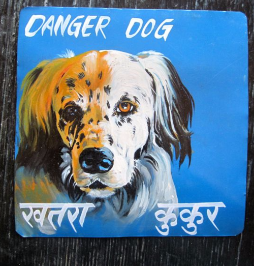 Folk art portrait of an English Setter hand painted on metal in Nepal
