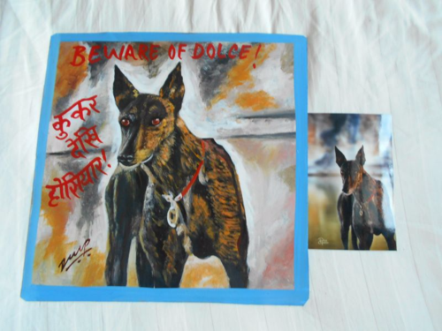 Folk art portrait of a Greyhound hand painted on metal in Nepal