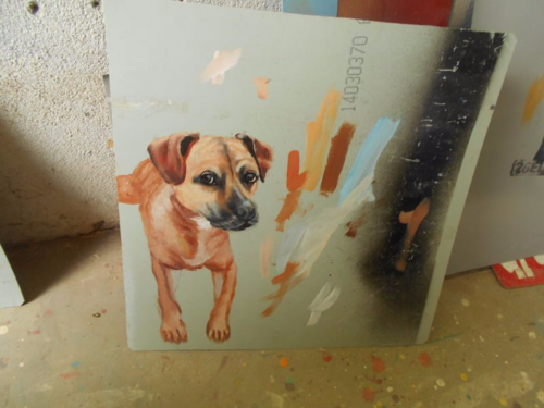 Folk art portrait of a boxer mix dog hand painted on metal in Nepal