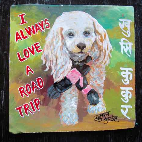Folk art portrait of an Apricot Poodle hand painted on metal by a sign painter in Nepal