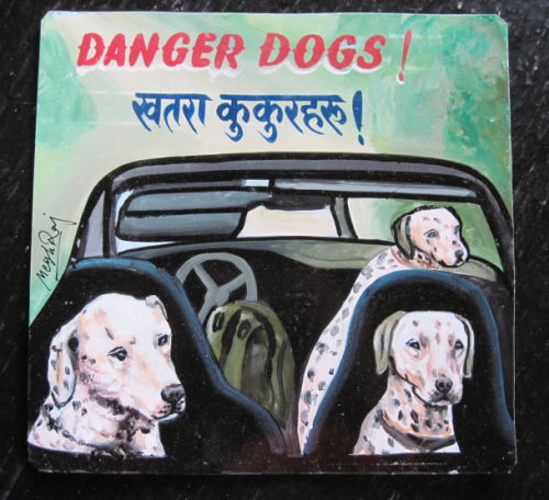 Folk art portrait of Dalmatians in a Porche Convertible hand painted on metal in Nepal