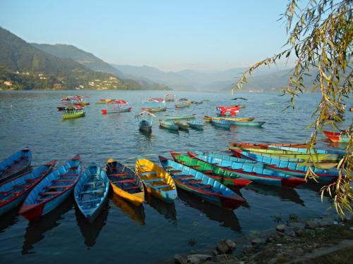 Boats along the shore of Lake Fewa