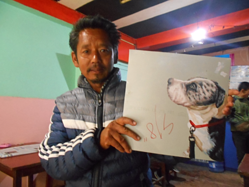 Folk art portrait of a rescue dog hand painted on metal by an artist in Nepal