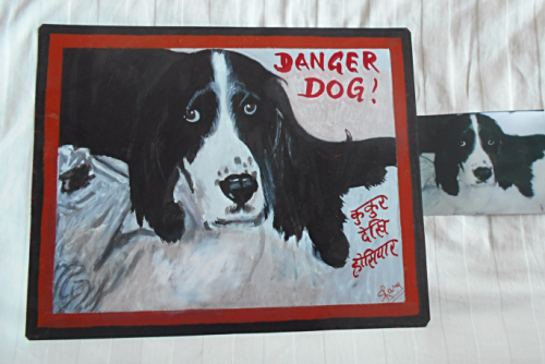 Folk at beware of Springer Spaniel hand painted on metal in Nepal