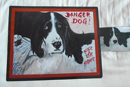 Folk at beware of Springer Spaniel hand painted on metal in Nepal