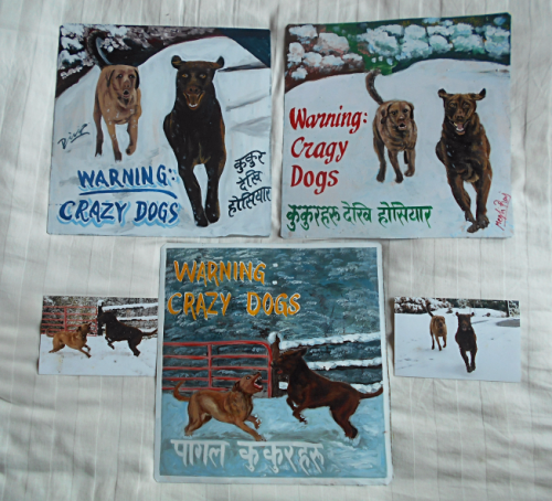 Folk art portrait of Chesapeake Bay Retrievers playing in the snow hand painted on metal in Nepal