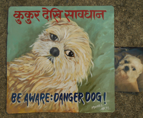 Folk art portrait of a rescue Shitzu mix hand painted on metal in Nepal