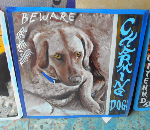 Folk art beware of dog sign (Chesapeake Bay Retriever) hand painted on metal in Nepal