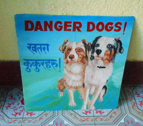 Folk art portraits of Australian Shepherds hand painted on metal in Nepal