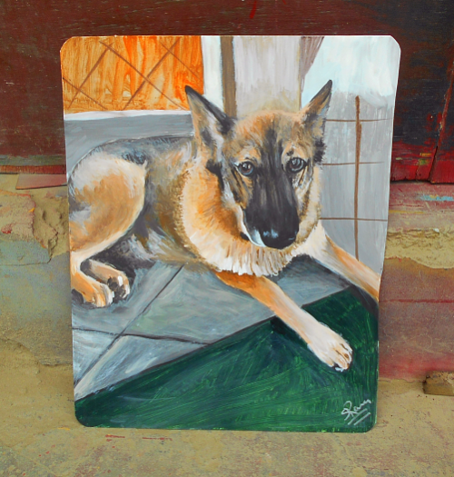 Folk art portrait of a German Shepherd hand painted on metal in Nepal