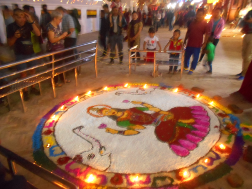 Rangoli on the Boudha Stupa draws many admirers