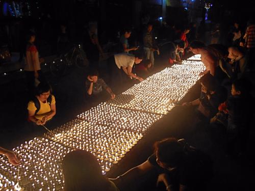 Butter lamps heat the night around Boudha Stupa