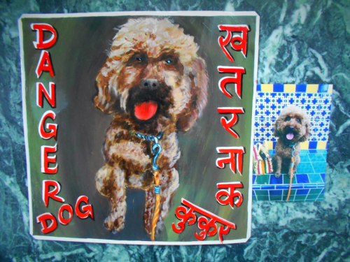 Folk art portrait of a Labradoodle hand painted on metal in Nepal