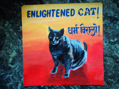 Folk art portrait of a Russian Blue Cat hand painted on metal in Nepal