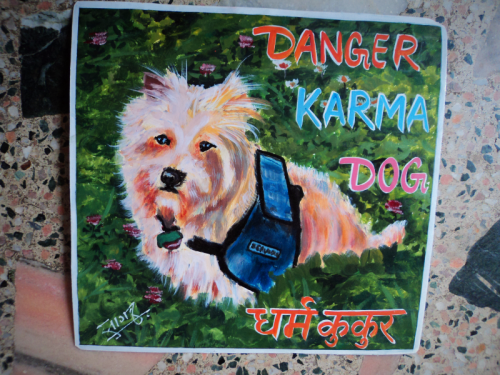 Folk art portrait of a service dog hand painted on metal in Nepal