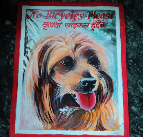 Folk art portrait of Yorkie hand painted on metal in Nepal