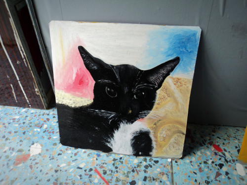 Folk art portrait of a Tuxedo Cat hand painted on metal in Nepal