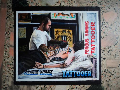 Folk art portrait of a tattoo artist hand painted on metal in Nepal